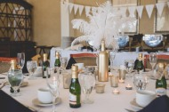 Feather centerpieces with wine bottle. Great Gatsby Bridal Shower. Bridesmaidsconfession.com